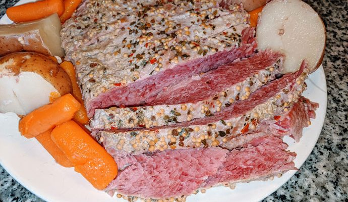 Sliced and Seasoned Corned Beef with Carrots and Potatoes