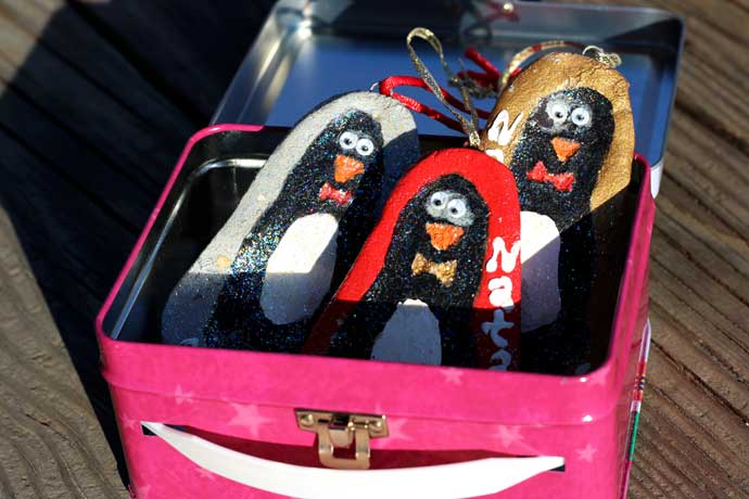 Salt Dough Penguin Footprint Ornaments in a Metal Lunch Box - Red, Silver, and Gold