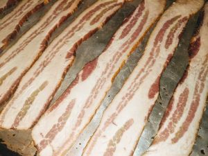 Cooking bacon on a pan