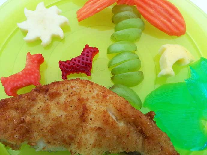 Tropical Toddler Food Closeup - Fried Flounder, Strawberries, Grapes, and Carrots