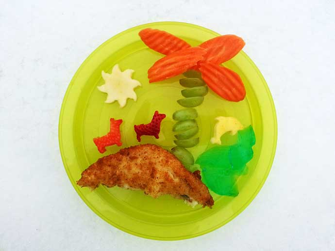 Tropical Meal Ideas for Toddlers - blue Jello, Grapes and Carrots palm tree, fried flounder beach, and fruit cut out as a dog and a dolphin