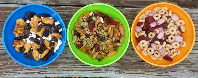 Homemade Trail Mix Recipes for Kids Featuring Goldfish, Cheerios, Raisins, Craisins, Cheerios, and more in colorful bowls
